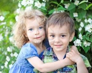 9767404-happy-smiling-children-in-summer-nature-background